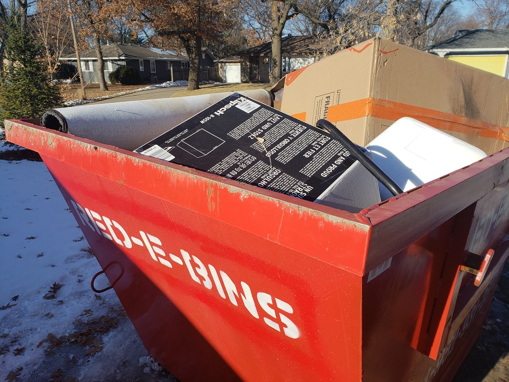 Redebins Full Dumpster garage clean out